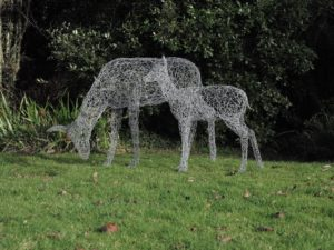 Wire deer sculpture and wire fawn